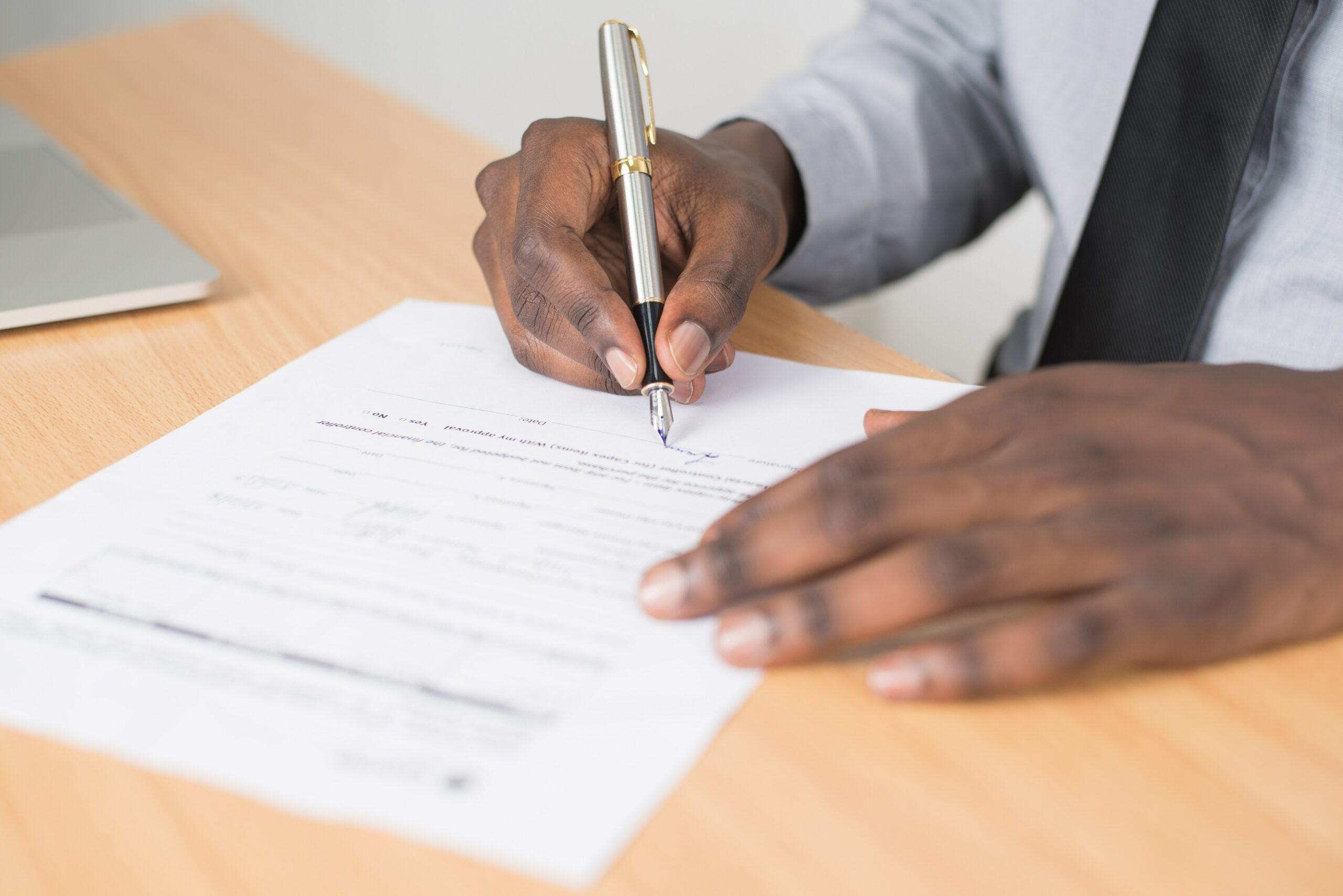 Man Signing Form
