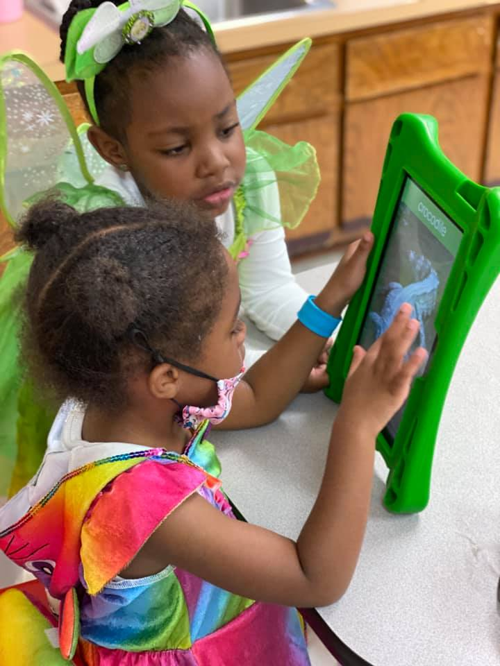 Kids learning on tablet